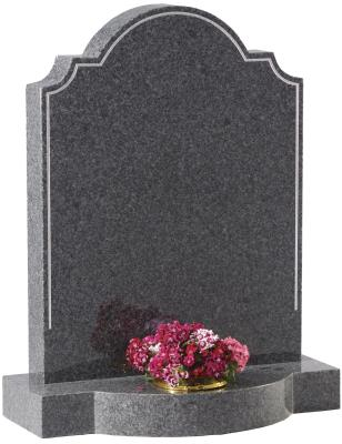 16040 - An ornate topped headstone. The pin line accentuates this classic shape and is further enhanced by the bow front base.