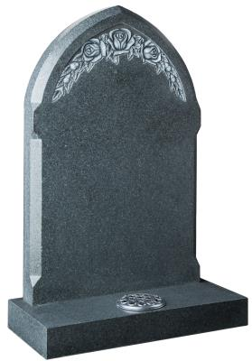 16066 - A gothic shaped headstone with a deep carved and highlighted rose design.